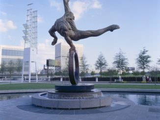"""Created for the 1996 Atlanta Olympics, """"Flair Across America - The Gymnast"""" by sculptor Richard MacDonald is a celebration of the triumph of the human spirit - the dedication, tenacity and determination of every individual in the pursuit of excellence. """"Flair Across America"""" is a the 26-foot high heroic bronze monument that resides permanently at Georgia International Plaza in Atlanta, Georgia. (PRNewsFoto/Richard MacDonald Studios, Inc.)"""